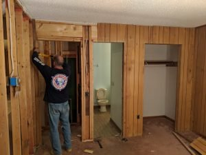 man constructing with wood beams in the house