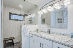 black and white granite bathroom sink countertop and tiled shower