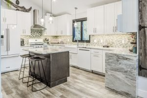 entrance to modern kitchen with granite countertops and tiled backsplash