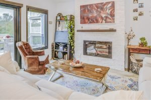 Living room with fireplace surrounded by brick-like texture