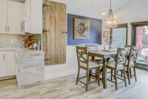 dining room with hardwood floors and accents with granite kitchen counter