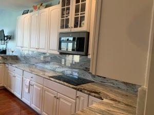 kitchen with granite countertop and backsplash